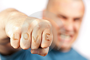 Aggressive man with words LOVE on his knuckles