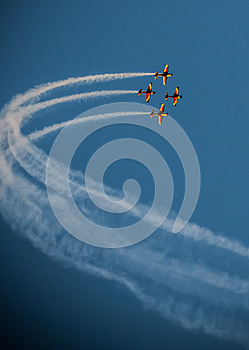 Airplane air show team smoke trail Synchronized