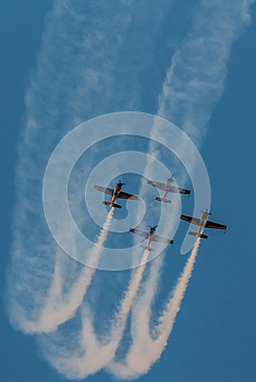Airplane air show team smoke trail Synchronized