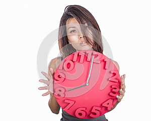 Asian woman holding clock