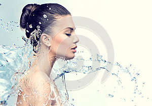 Beautiful model woman with splashes of water