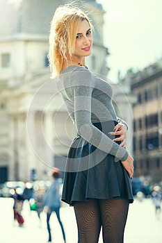 Young model woman outdoors. Blonde girl in the town, happily young tourist woman