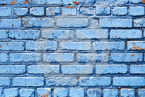 Blue Brick Wall with peeling paint background texture