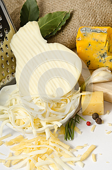 Bowl with grated cheese and spices