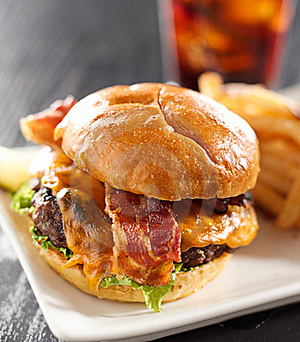 Cheeseburger meal with drink