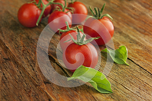 Cherry tomatoes on a wooden surface