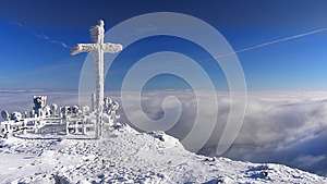 Christian Cross in mountains