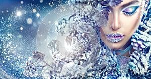 Christmas girl. Winter holiday makeup with gems on lips