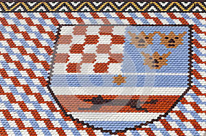 Colored tiles with the coats of arms of Croatia, Dalmatia and Slovenia.. St Marks Church in Zagreb in Croatia.