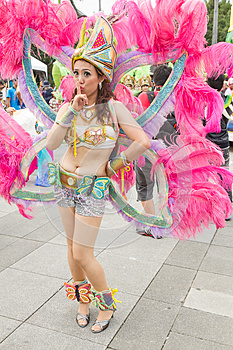 Costumed revelers march with floats in the annual Dream Parade o