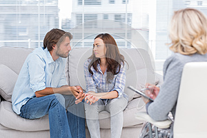Couple looking to each other during therapy session