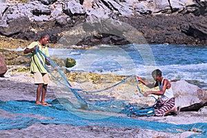 Fishermen preparing nets.
