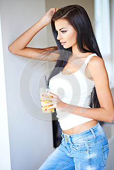 Fit healthy woman drinking orange juice