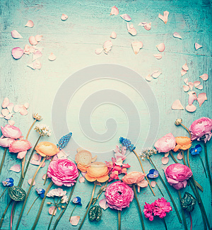 Floral frame with Lovely flowers and petals, retro pastel toned on vintage turquoise background