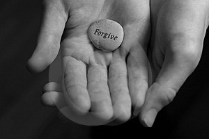 Forgive stone in palm of hand