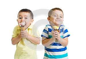 Funny children or kids, little boys eat ice-cream