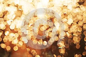 Glitter festive christmas lights background. light and gold defo