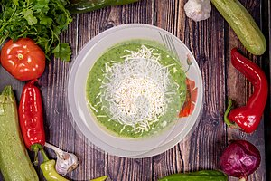 Gourmet spinach soup grated cheese in a bowl