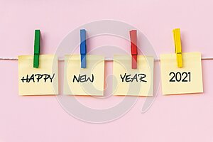 Happy New year 2021 greeting on hanging paper note