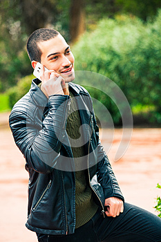 Happy young man with smartphone. Talking on the phone.
