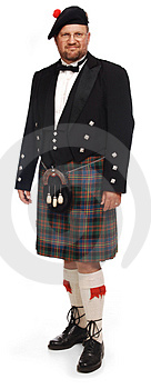 Highlander in kilt on white