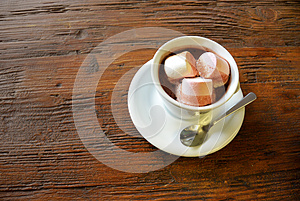 Hot chocolate with marshmallows on wooden surface