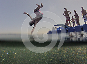 "Kids jumping from floating sea platform"" border=""0"