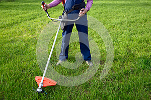 Man mows a grass