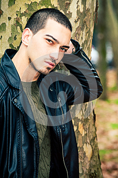 Man portrait outdoors. Handsome natural male