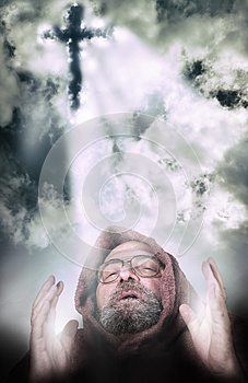 Man vocation illuminted by cross light from the clouds