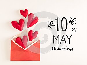 Mother`s Day message with red heart cushions
