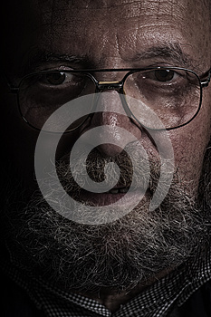 Old man with glasses and beard. Dragan effect