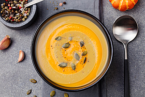 Pumpkin and carrot soup with seeds Top view