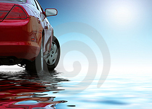 Red sporty car reflects in water
