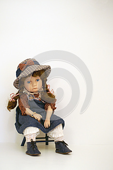 Sad faced girl doll sitting on a time out chair