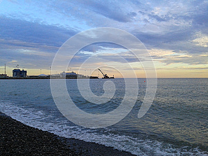 Seaport Sochi, sea and clouds at sunset