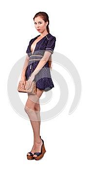 Sexy girl in short dress with handbag