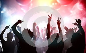 Silhouettes of young people dancing in club. Disco and party concept
