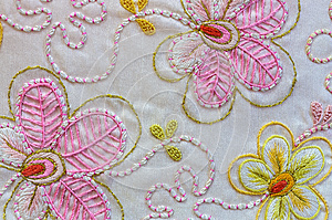 Silk embroidery flowers on white background