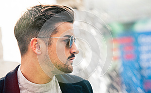 Stylish straight hair. Man profile with sunglasses.