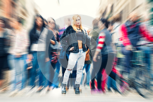 Teen blonde girl in the crowd city. Urban street city life