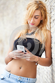 Teenage girl with mobile smartphone outdoor. Modern youth.