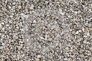 Small stone, crushed stone. Used for laying asphalt. Background .