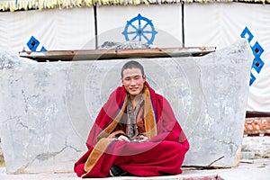 Tibetan monk sitting