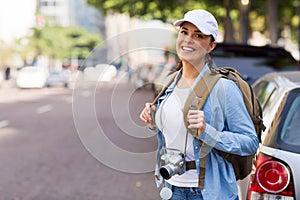 Tourist standing sidewalk