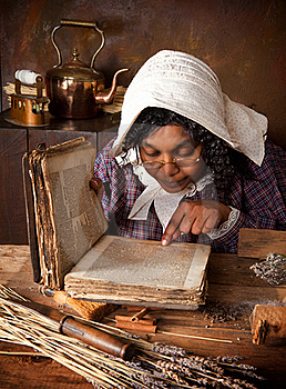 Vintage herb woman reading recipe