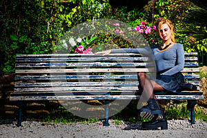 Waiting for love. Young girl in love on the bench.