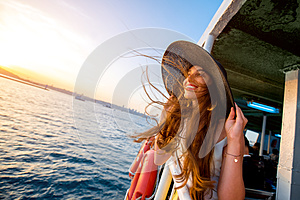"Woman enjoying the sea from ferry boat"" border=""0"
