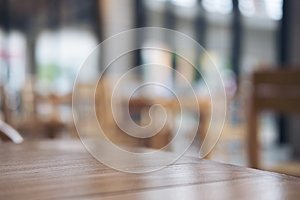Wooden table and chair in cafe with blur bokeh abstract