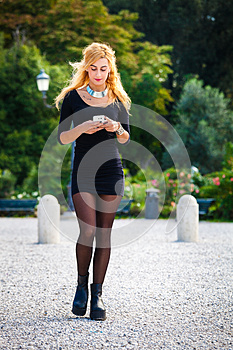 Young girl with smartphone. Mobile addiction, contemporary social society.